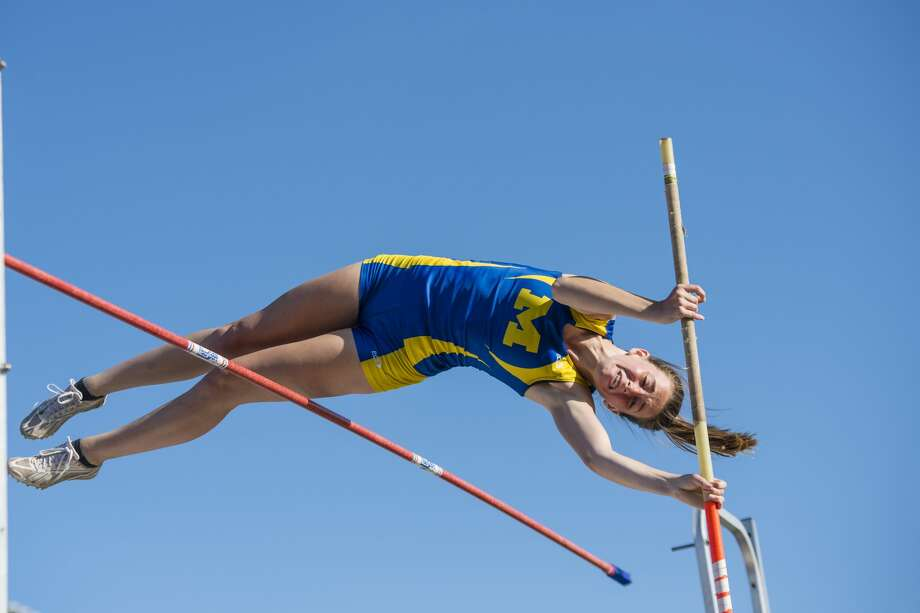 Midland's Sarah Wing competes in pole vaulting at a track and field meet hosted at Mount Pleasant High School on Monday. Photo: Danielle McGrew Tenbusch