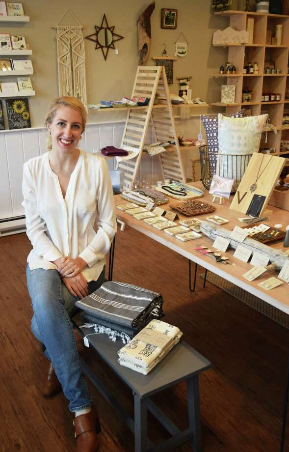 The Safari Collective in New Milford will celebrate its one-year anniversary May 27. Owner Sarah Lopes is shown above in the Railroad Street store. Photo: Deborah Rose / Hearst Connecticut Media / The News-Times  / Spectrum