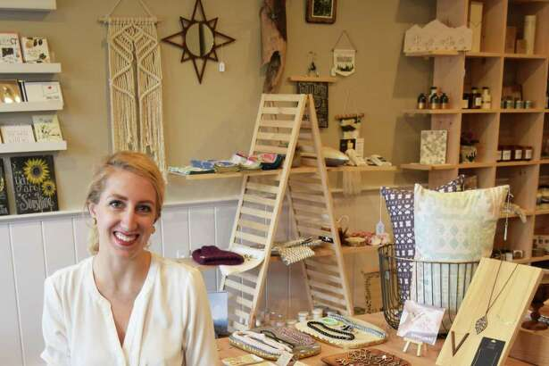 The Safari Collective in New Milford will celebrate its one-year anniversary May 27. Owner Sarah Lopes is shown above in the Railroad Street store.