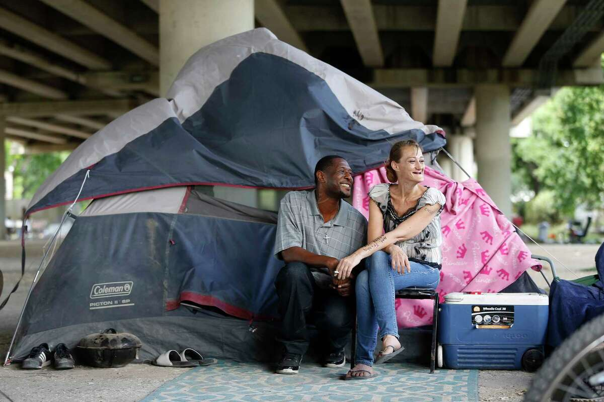 Tammy Kohr, one of three plaintiffs in the lawsuit being filed by the ACLU of Texas, asking a federal judge to halt the city's new ordinances limiting panhandling and camping in public, with her friend Carl Harvey, in her encampment near Wheeler and Caroline, Monday, May 15, 2017, in Houston.