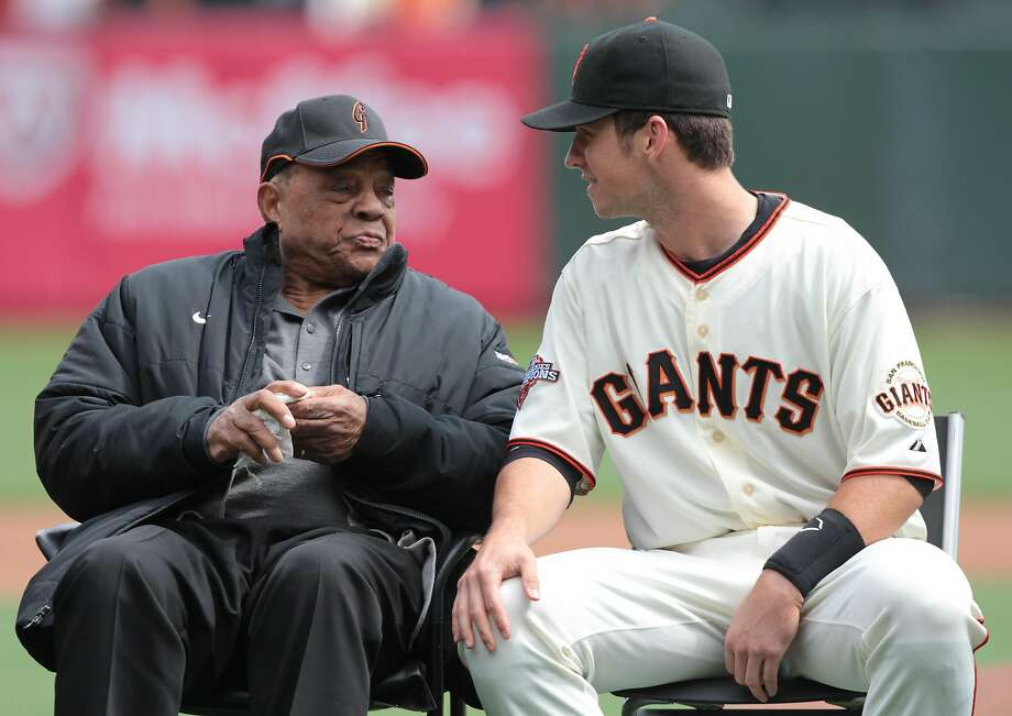 Buster Posey talks with Willie Mays at an awards ceremony for the 2012 MLB MVP award in San Francisco, on Saturday, April 6, 2013. Photo: Mathew Sumner, Special To The Chronicle