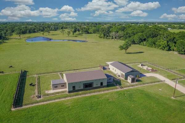 Price:  $1,299,000   36488 FM 1736 Rd, Hempstead, TX    Barnyard banter:  Who says industrial buildings have to look slapdash? This beautiful barndominuim will set you back a pretty penny. But you'll enjoy a gated house with an entertainment room and a high-ceilinged living room. If that's not enough, there's 50 acres of land to roam on.