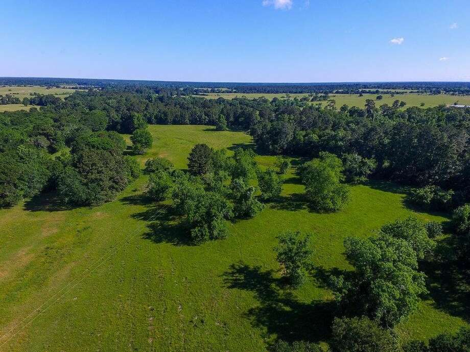 Price: $775,000 Highway 75, Huntsville, TX Barnyard banter: Does 50 acres sound good? How about 100? That's what you'll be getting along with this dwelling. The 3,800-square-foot home comes with a 1,300-square-foot covered porch that's ideal for an outdoor cookout. Photo: Realtor.com