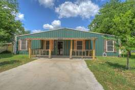 Price:  $475,000    3731 Lakeview Dr, Cottonwood Shores, TX     Barnyard banter:  This barndominium stays true to its metal roots. None of the rooms inside has a finished ceiling. Instead, the home makes use of the barn's metal roof. Never mind the echo, because it also comes with an excellent view of the nearby Colorado River.