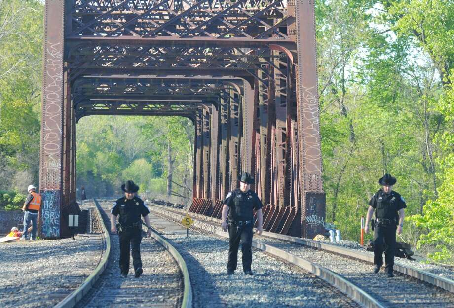 Columbia County deputies search the train tracks near the area where, the sheriff's departments says, a man was hit and killed by an Amtrak work train on Tuesday. Photo: Lance Wheeler / Special To The Times Union