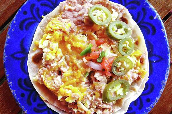 Breakfast pirata taco on two flour tortillas from Taco Palenque.