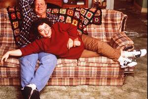 """FILE - Roseanne Barr and John Goodman are shown in character from the TV show """"Roseanne"""" in this 1989 file photo.  Tempestuous Roseanne is at it again, reportedly threatening to quit her ABC comedy series.  And this time, she may have company. Her co-star, John Goodman, didn't show up for work Wednesday, Oct. 18, 1995 on the set of ``Roseanne.'' Roseanne said Tuesday she'd leave the show after her bid to fire executive producer Eric Gilliland was stymied by production company Carsey-Werner Co., the trade paper Daily Variety said Wednesday.  (AP Photo/ABC)"""