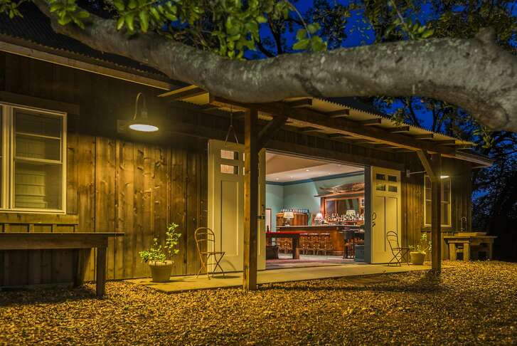 An entertainment barn sits detached from the main home.�
