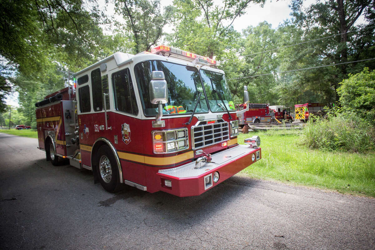 Firefighters respond to a mobile home fire on Tuesday, May 16, 2017, on the 18000 block of Walnut Hills Drive in east Montgomery County.
