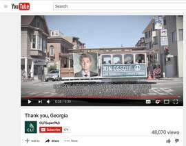 This screenshot from a Youtube video by CLFSuperPac shows a Jon Ossoff ad on a cable car.