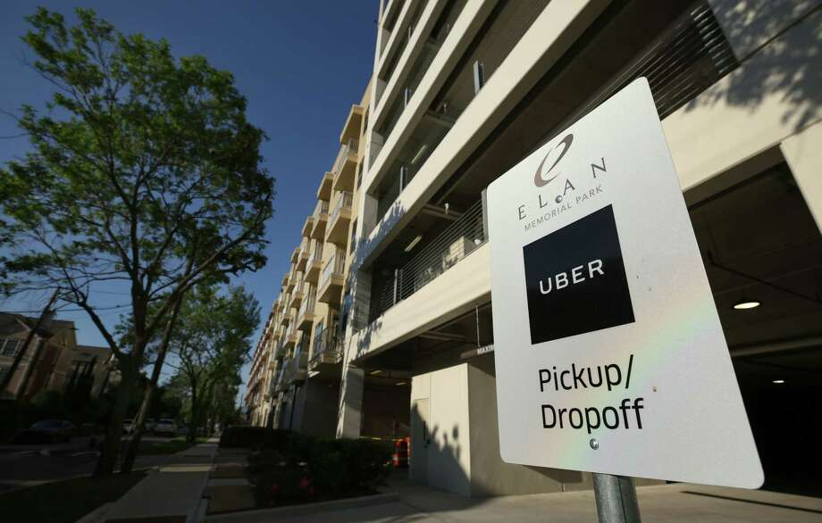 At the Elan Memorial Park apartments, one of the Greystar complexes debuting Uber spaces, residents calling for Uber rides will select one of three pickup spots.  Photo: Godofredo A. Vasquez, Staff / Godofredo A. Vasquez