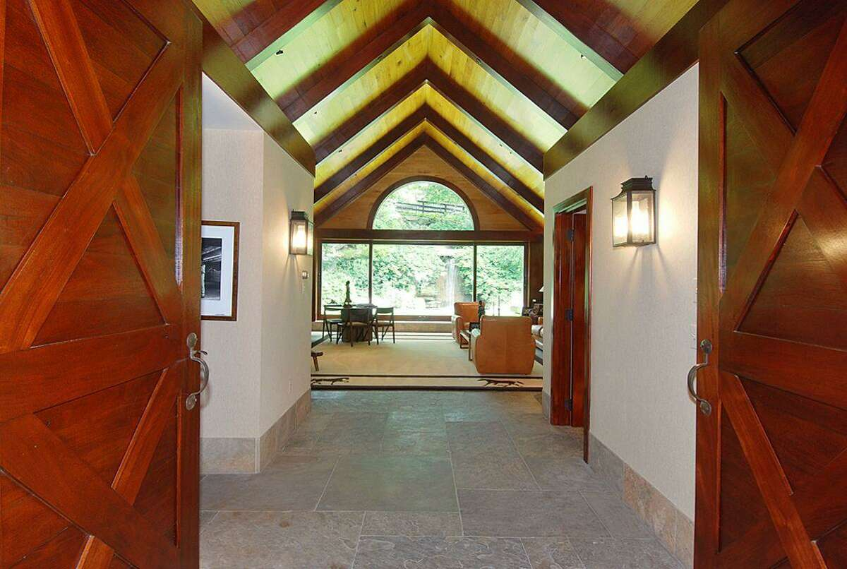 The 8,000-square-foot mahogany and butternut barn includes 11 horse stalls, veterinary facilities, two tack rooms, five bathrooms, and kitchenette.