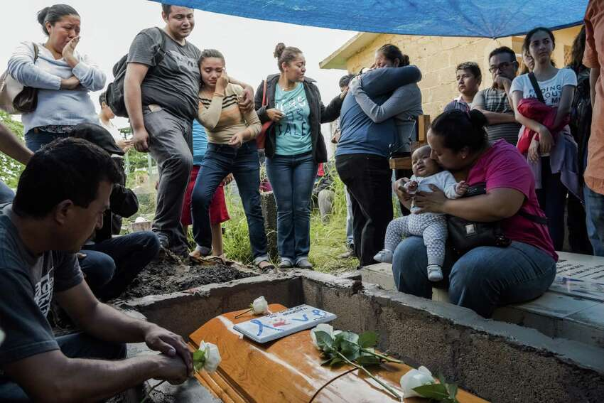 Pedro Tamayo Rosas Alicia Blanco Beisa, wife of Pedro Tamayo Rosas, a crime reporter who was murdered, holds their 5-month-old grandson at his funeral in Tierra Blanca, Veracruz, Mexico, July 22, 2017. The Mexican state of Veracruz is the most dangerous place to be a reporter in the Western Hemisphere.