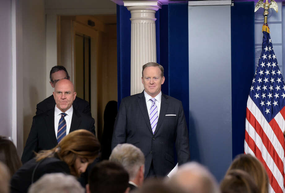 White House press secretary Sean Spicer, right, and National Security Adviser H.R. McMaster, left, arrive for a briefing at the White House in Washington on Tuesday. Photo: Associated Press