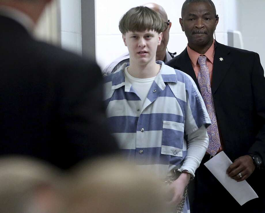 Dylann Roof enters court in April to plead guilty plea to killing nine churchgoers in Charleston, S.C. Recently released videos show Roof interacting with his family a week before sentencing. Photo: Grace Beahm, Associated Press