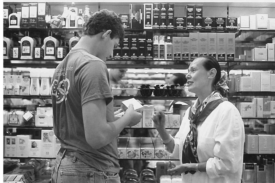 Baroness Amber Wolsvander Wel van Heemstra helps James Barker, left, choose a gift at Parfumerie Douglas on Greenwich Avenue on Friday, June 12, 1992. Members of a Greenwich High School buddy program for the intellectually disabled would meet behind Woolworth's that morning to shop along the Avenue between 10:15 a.m. and 11 a.m. and then eat lunch. Photo: Mel Greer /