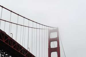 (FILES) This file photo taken on September 10, 2011 shows  a surf-glider beneath the Golden Gate Bridge near Fort Point in San Francisco. Judge William H. Orrick of United States District Court for the Northern District of California on April 25, 2017, temporarily blocked efforts by the administration of US Prseident Trump to withhold federal funding from cities that limit their cooperation with federal immigration enforcement.  / AFP PHOTO / Frederic J. BROWNFREDERIC J. BROWN/AFP/Getty Images