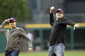 FILE - In this May 8, 2012, file photo, ESPN radio hosts Mike Greenberg, left, and Mike Golic throw out first pitches before a baseball game in Cleveland, Ohio. The network announced on May 16, 2017, that Greenberg would be leaving the longtime morning radio show he co-hosts with Golic to host a new morning TV show on ESPN TV that will premier Jan. 1.