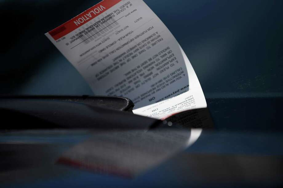 A parking ticket is placed under the windshield wiper of a car on State Street on Monday, Aug, 29, 2016, in Albany, N.Y. (Will Waldron/Times Union) Photo: Will Waldron