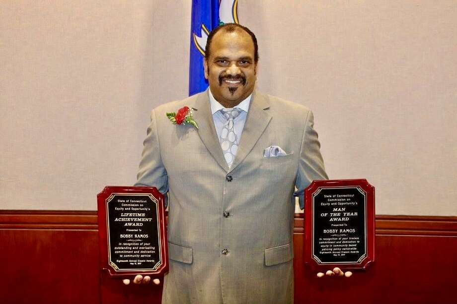 Bobby Ramos, the founder of the Stratford Guardians minority police group, was named Man of the Year and presented with the 2017 Lifetime Achievement last week by the state Commission on Equity and Opportunity. Photo: Contributed Photo / Contributed Photo / Connecticut Post Contributed