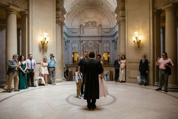 Destiny Cosio, Joshua Sanford, with their daughter, Ava, and son, Noah, surrounded by friends and family at their wedding ceremony at City Hall in San Francisco on May 12th, 2017.