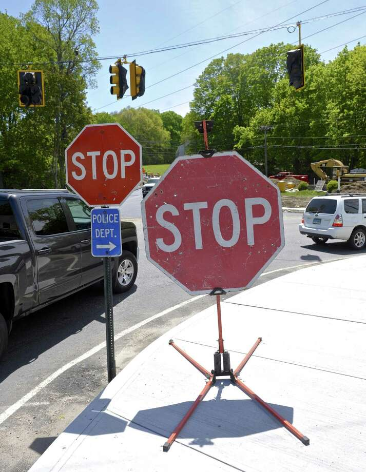 Temporary Stop signs at the Plumtrees Bridge project may no longer be necessary as the contractor, Nagy Brothers Construction, plans on turning on the new traffic lights and using the new section of road on Wednesday, May 17.   Tuesday, May 16, 2017, in Bethel, Conn. Photo: H John Voorhees III / Hearst Connecticut Media / The News-Times