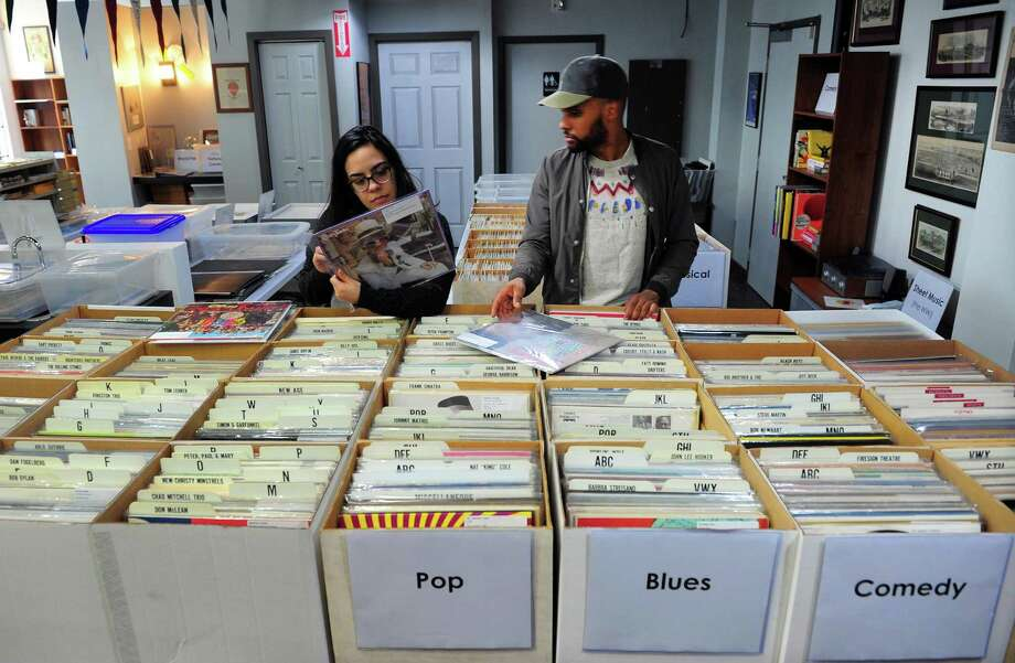 Kat Ferreira and Rus Cruz, both of Bridgeport, shop at a new business: Academy Books & Records, on Fairfield Avenue in downtown Bridgeport, Conn., on Saturday May 13, 2017. The owner is Mike Roer, president of the Fairfield-based Entrepreneurial Foundation. Photo: Christian Abraham / Hearst Connecticut Media / Connecticut Post
