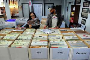 Kat Ferreira and Rus Cruz, both of Bridgeport, shop at a new business: Academy Books & Records, on Fairfield Avenue in downtown Bridgeport, Conn., on Saturday May 13, 2017. The owner is Mike Roer, president of the Fairfield-based Entrepreneurial Foundation.