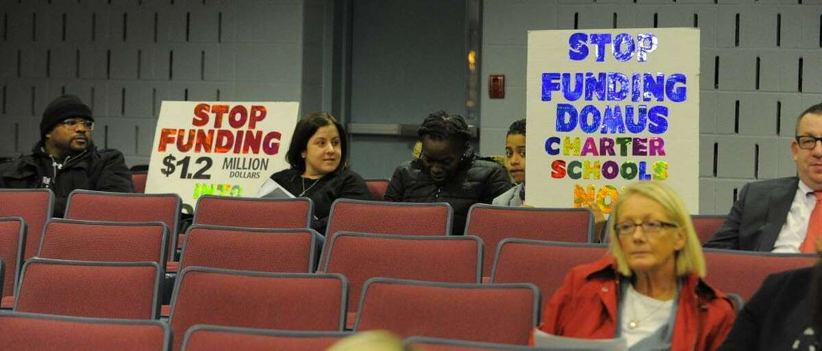 FILE - Jaclyn Pioli, second from left, during a Board of Education public hearing at Westover Magnet Elementary School in Stamford on Feb. 7, 2017.