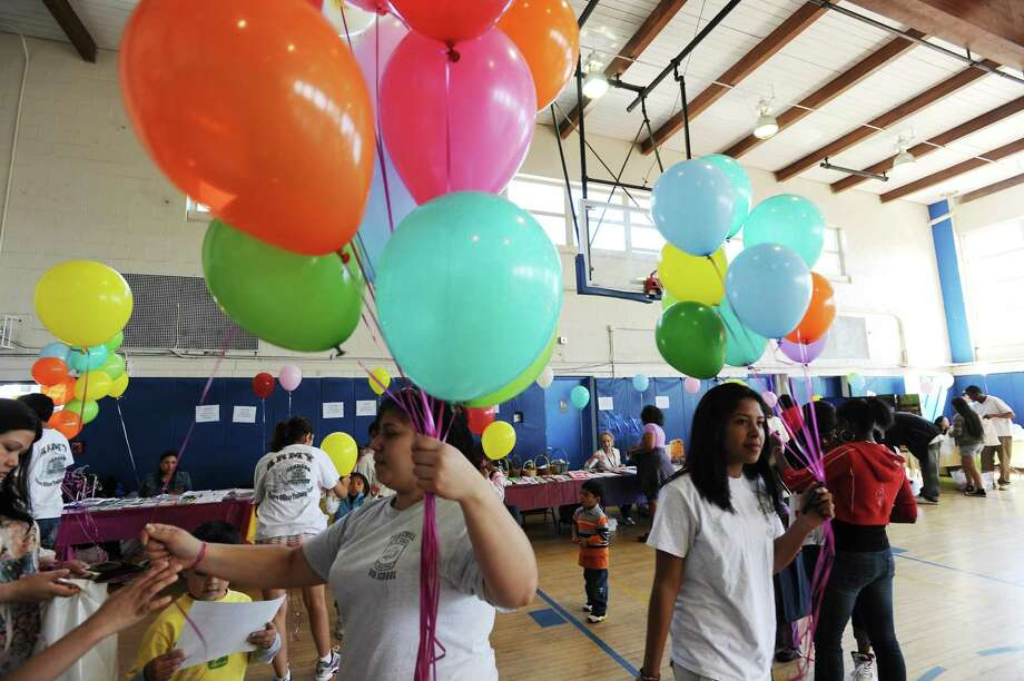 Westhill High School students pass out balloons at the 10th Annual Family Fun Day at the Yerwood Center in Stamford, Conn. on Saturday May 15, 2010. Photo: Kathleen O'Rourke / ST / Stamford Advocate