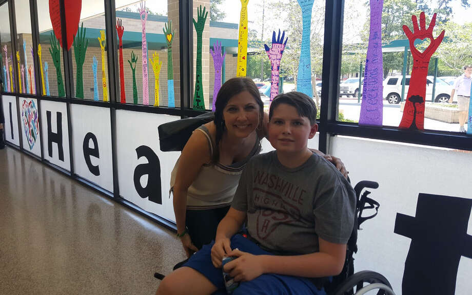 Tracy Melim and her son Seth Haynes attend a Welcome Home celebration May 13 at Creekwood Middle School in honor of Haynes' return to Kingwood. Photo: Melanie Feuk