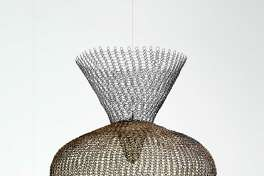 """Ruth Asawa's """"S. 562, Double Cone Form with Central Sphere,"""" from 1953, a work of galvanized steel wire and brass wire, is among works on view May 18-Oct. 1 in the show """"In the Studio: Craft in Postwar America, 1950-1970"""" at the Museum of Fine Arts, Houston."""