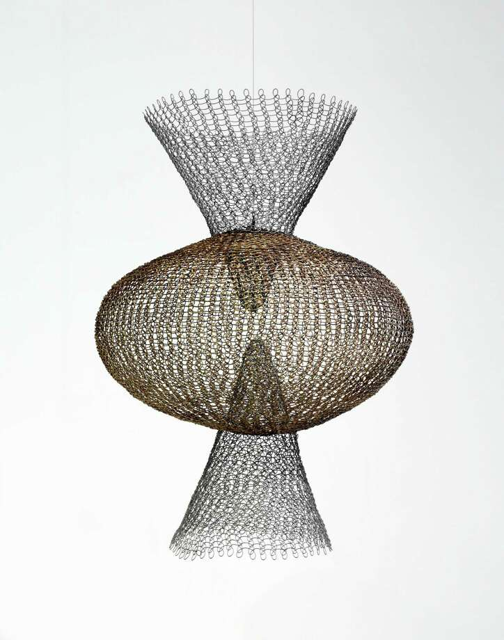 "Ruth Asawa's ""S. 562, Double Cone Form With Central Sphere"" is among works on view in the show ""In the Studio: Craft in Postwar America, 1950-1970"" at the Museum of Fine Arts, Houston. Photo: Thomas R. DuBrock, Photographer / Photograph © The Museum of Fine Arts, Houston"