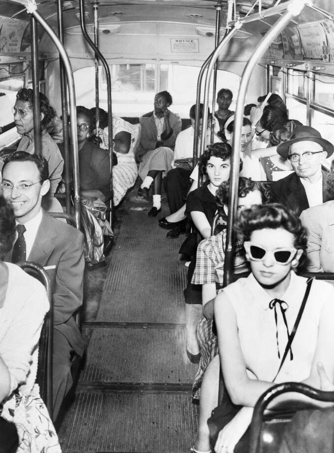 Despite a court ruling on desegregating buses, white and blacks continue to be divided by their own choice. Photo: Bettmann/Bettmann Archive
