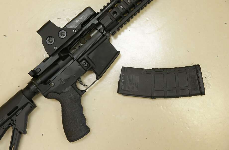 California banned sales of high capacity detachable magazines like this one on a custom made semi automatic hunting rifle in 2000, and in 2013 added to the ban. Photo: Rich Pedroncelli, Associated Press