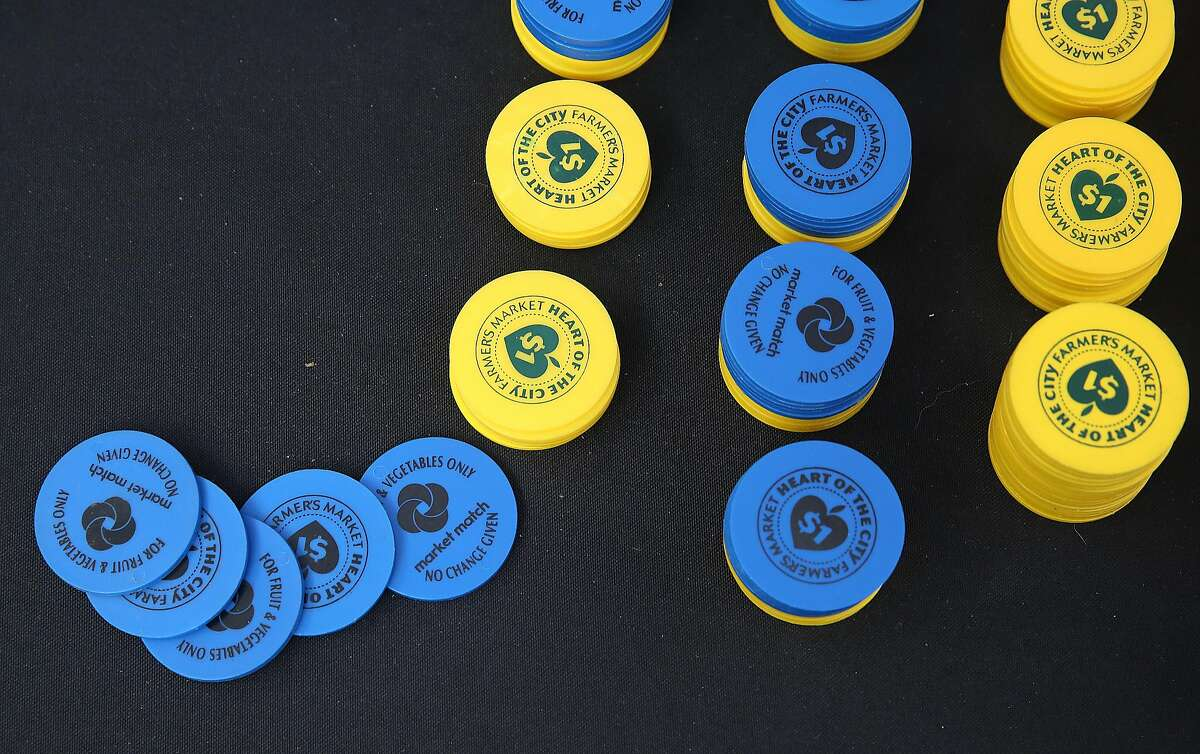 CalFresh food stamp tokens at the Heart of the City Farmer's Market in San Francisco. The Trump administration announced that legal immigrants who use public benefits, including food stamps, may be denied green cards.