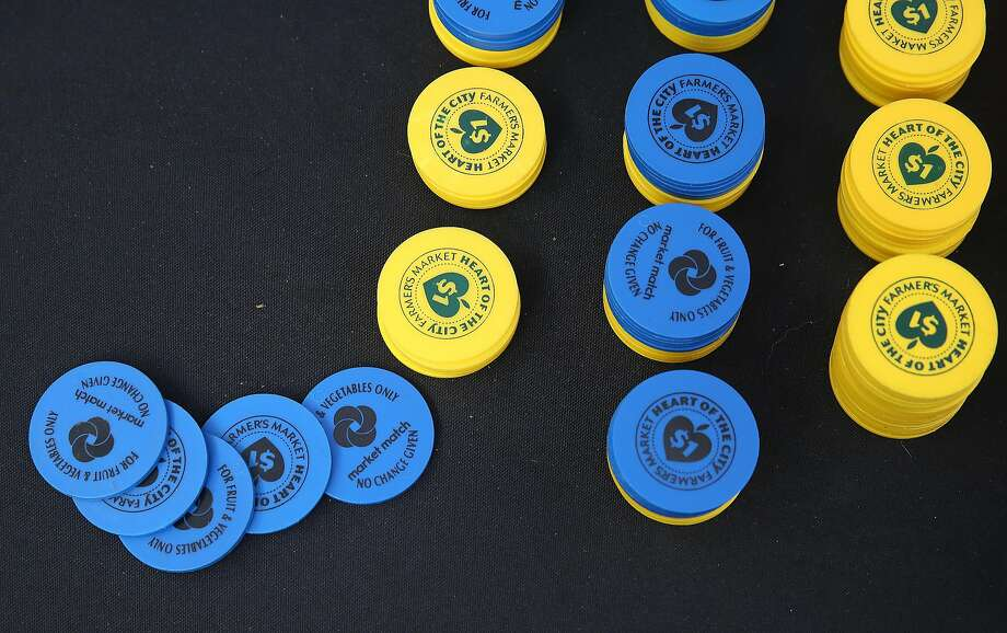 Food stamp tokens at the Heart of the City Farmer's Market in San Francisco. Photo: Liz Hafalia, The Chronicle