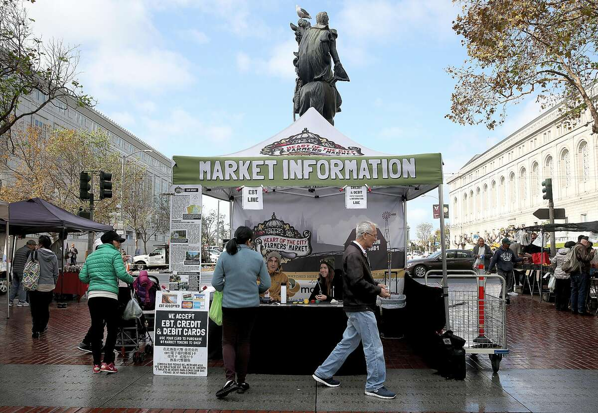 The kiosk where people can receive credit card and food stamp tokens at the Heart of the City Farmer's Market in San Francisco.