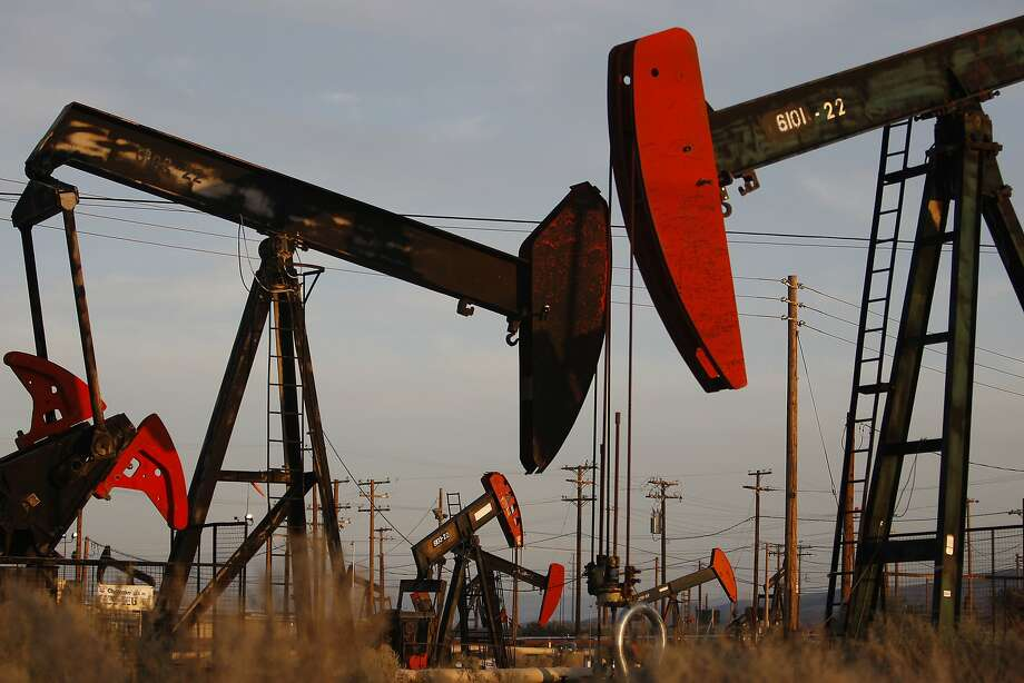 Pump jacks and wells are seen in an oil field on the Monterey Shale formation where gas and oil extraction using hydraulic fracturing, or fracking, is on the verge of a boom on March 23, 2014 near McKittrick, California. Photo: David McNew / Getty Images