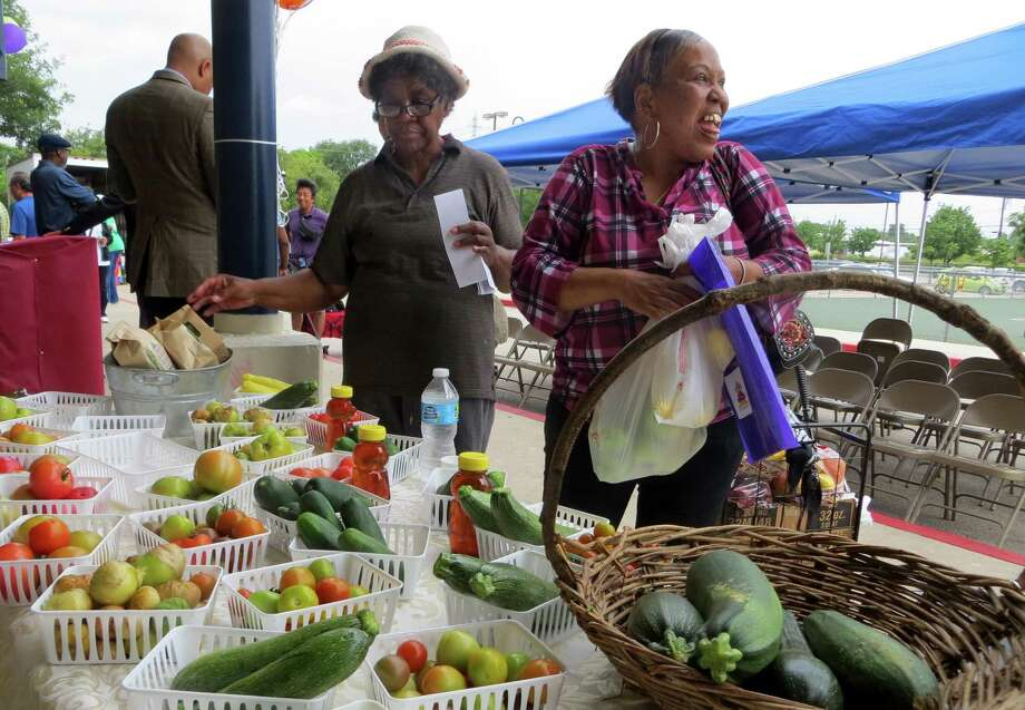 Betty Pryor (left) and Vernice Terrell shop at the farmers market at Wheatley Middle School held from 10 a.m. to 1 p.m. on the first Saturday of the month on the city's East Side. Photo: Zeke MacCormack /San Antonio Express-News / Staff