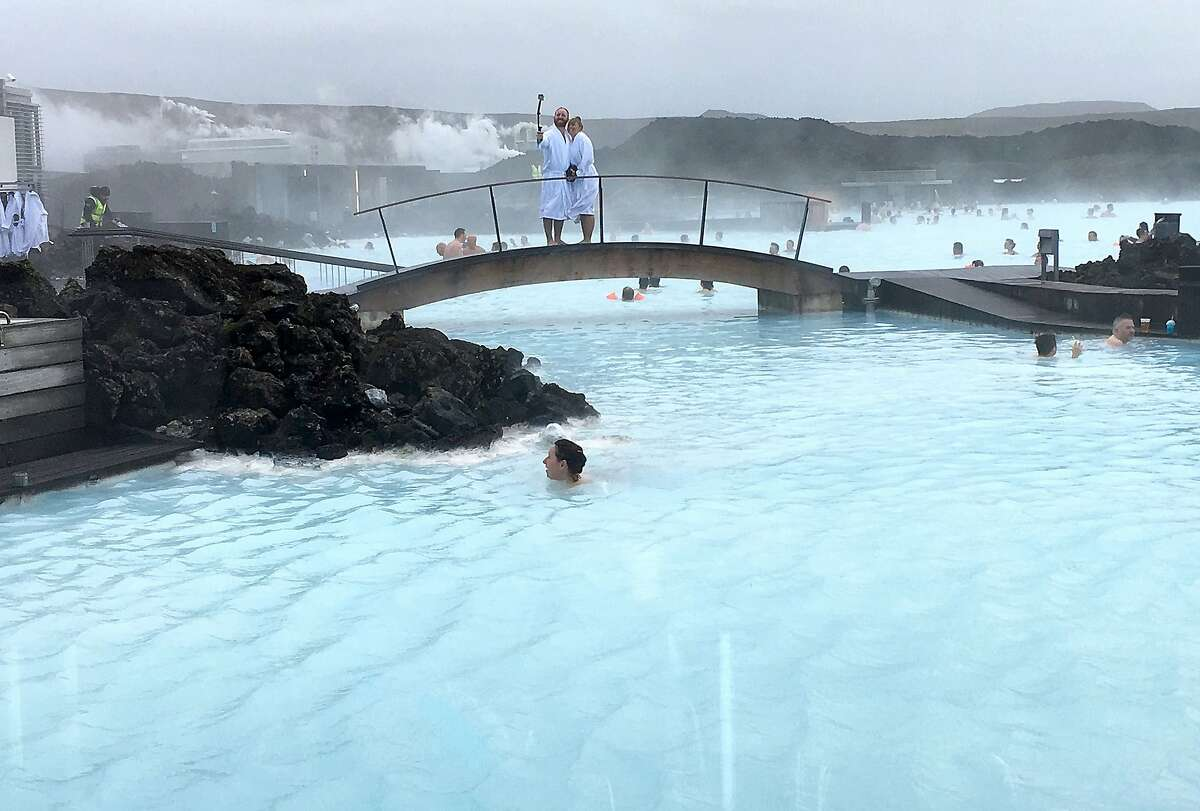 One of the most popular attractions in Iceland, the Blue Lagoon is a geothermal spa where visitors can swim and spread silica mud and algae masks on their faces. (Jessica Kwong/Orange County Register/TNS)