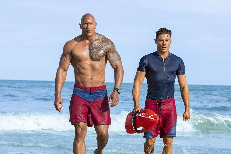 "This image released by Paramount Pictures shows Dwayne Johnson, Left, and Zac Efron in a scene from, ""Baywatch,"" in theaters May 25. (Frank Masi/Paramount Pictures via AP) Photo: Frank Masi, Associated Press"