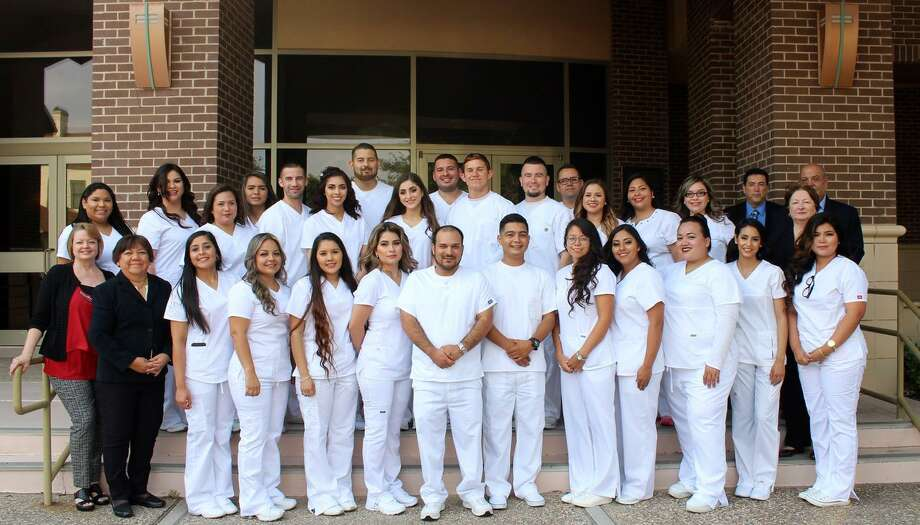 Graduates and faculty of the Associate Degree Nursing Program at Laredo Community College are pictured prior to the traditional pinning ceremony held to honor those who have completed the training for the nursing program. The ceremony was held on Tuesday, May 9, 2017 in the Guadalupe and Lilia Martinez Fine Arts Center theater at the Fort McIntosh Campus. Photo: LCC / Courtesy