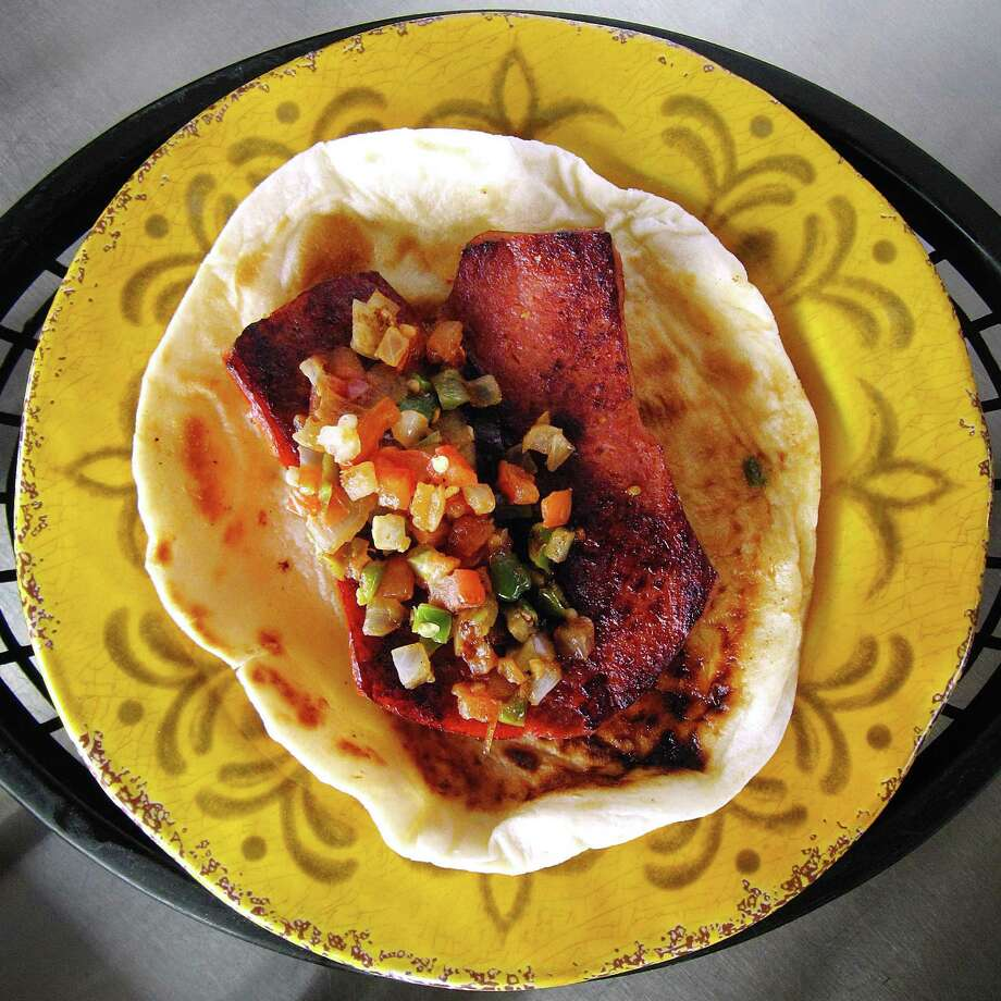 Country sausage link a la mexicana taco on a handmade flour tortilla from Tony's Tacos To Go. Photo: Mike Sutter /San Antonio Express-News