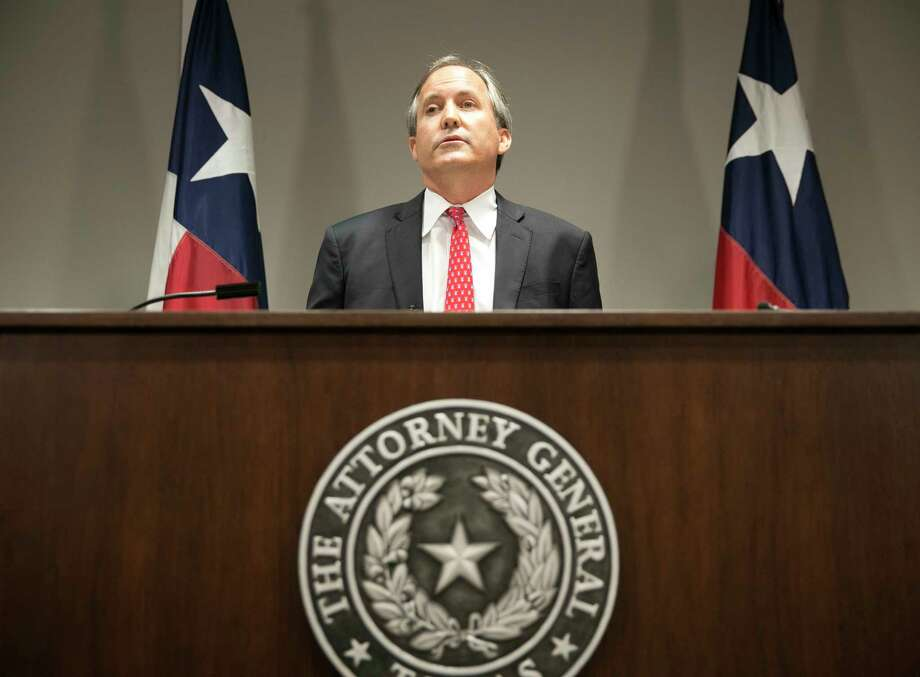 FILE - In this May 25, 2016 file photo, Republican Texas Attorney General Ken Paxton announces Texas' lawsuit to challenge President Obama's transgender bathroom order during a news conference in Austin, Texas. In Texas, reporters seeking public documents and data are increasingly running into a road block: the state attorney general's office. The agency is the arbiter of the state's open records laws, yet in recent years has been flooded with requests from governments at all levels seeking to withhold information. The agency almost always allows them to do so. (Jay Janner/Austin American-Statesman via AP) Photo: Jay Janner, MBO / Austin American-Statesman