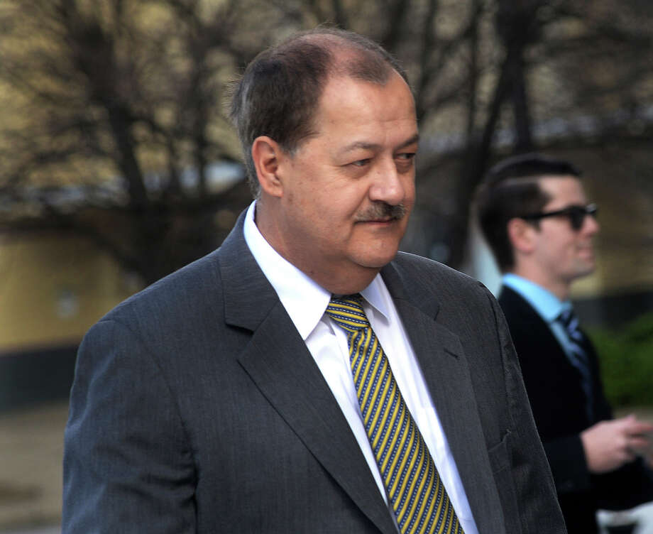 FILE - In a Wednesday, April 6, 2016, file photo, former Massey CEO Don Blankenship is escorted by Homeland Security officers from the Robert C. Byrd U.S. Courthouse in Charleston, W. Va. Blankenship has asked President Donald Trump to resist attempts in Congress to enhance criminal penalties for coal executives who violate mine safety and health standards. Blankenship, who recently was freed from federal prison, also asked the president in a letter Tuesday, May 16, 2017, to re-examine a federal investigation into the nation's worst coal mining disaster in four decades. (F. Brian Ferguson/Charleston Gazette-Mail via AP, File) Photo: F. Brian Ferguson, MBO / Charleston Gazette-Mail