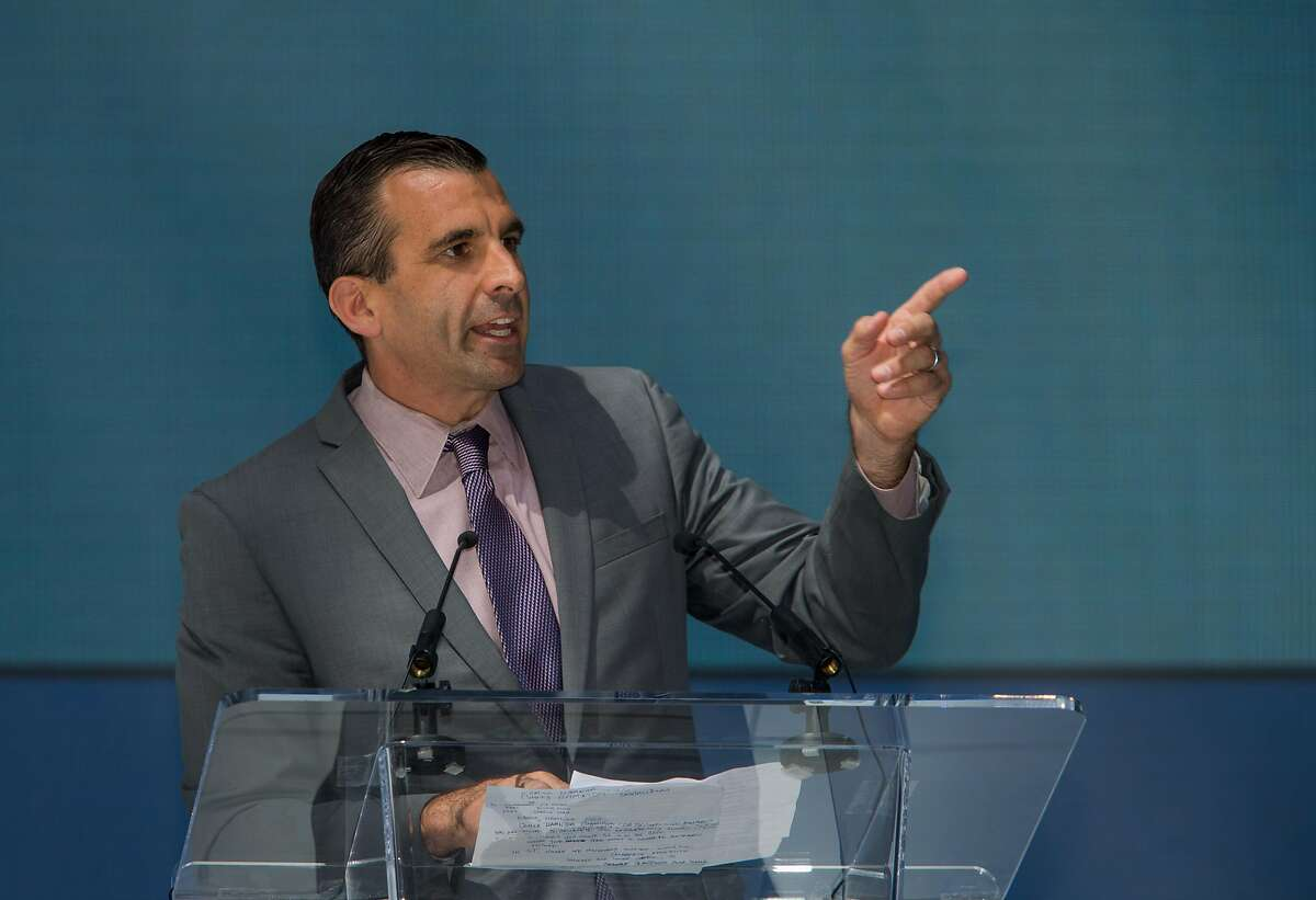 FILE-- San Jose Mayor Sam Liccardo addresses the crowd at Samsung's opening ceremonies of a new 1.1 million square foot research and development, sales and marketing center on Thursday, Sept. 24, 2015 in San Jose. Google is considering opening an enormous new office in San Jose, potentially bringing thousands of jobs there.