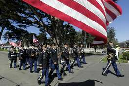 The 191st Army Band from Camp Parks marches during the Memorial Day Ceremony at the National Cemetery of The Presidio in San Francisco, Calif. on Monday, May 26, 2014.