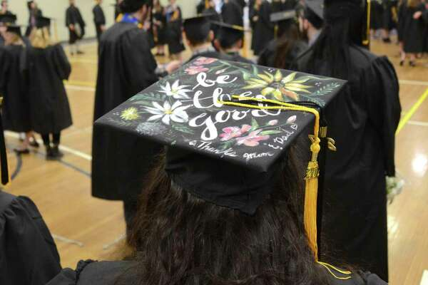 Mass-achusetts College of Liberal Arts graduate Kayla LaVoice wears a painted mortar board during com-mencement Saturday in North Adams, Mass.