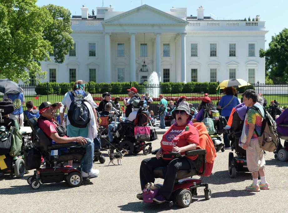 Protesters supporting people with disabilities gather outside the White House in Washington, Monday, May 15, 2017. (AP Photo/Susan Walsh) Photo: Susan Walsh, STF / Copyright 2017 The Associated Press. All rights reserved.